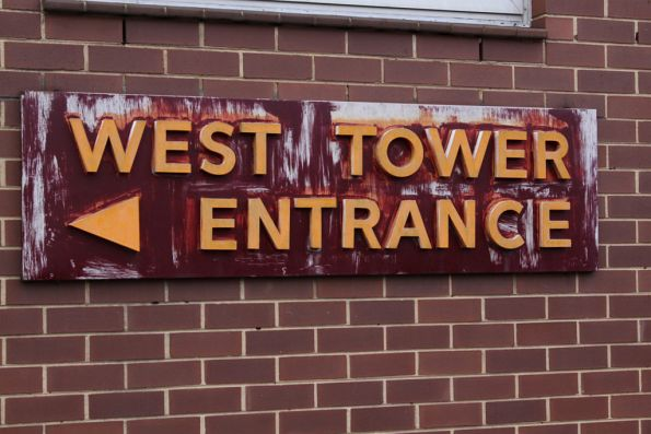 Faded sign at the entry to West Tower