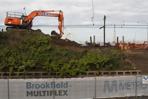 Excavator digging away at the approach to the hump