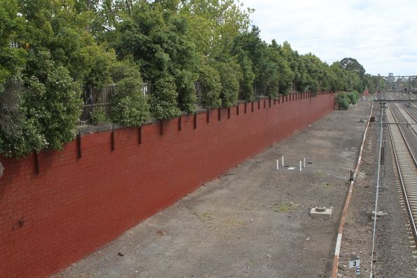 Retaining wall at Kensington freshly repainted in brown