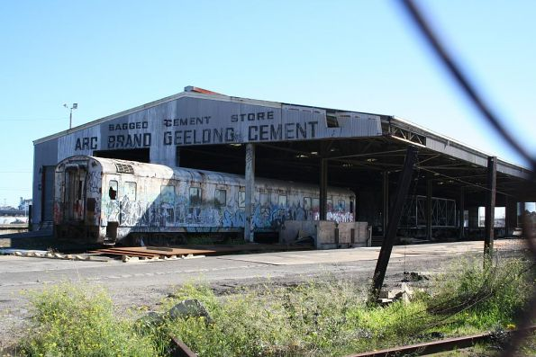 Cement shed at the south end of the Melbourne Steel Terminal, with Wegmann carriage OWA91 stored underneath