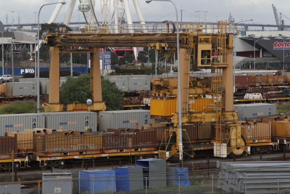 Mi Jack crane transferring 'butterbox' coil steel containers between broad and standard gauge wagons at the Melbourne Steel Terminal