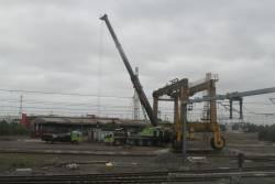 Crane ready to dismantle the Mi-Jack gantry crane once used for transhipping containers