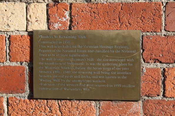 Plaque on the Flinders Street retaining wall, built in 1890