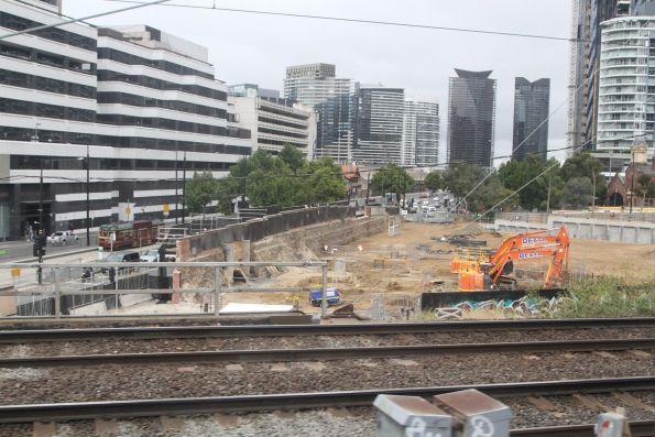 Excavating behind the Flinders Street retaining wall to make room for the Collins Square development