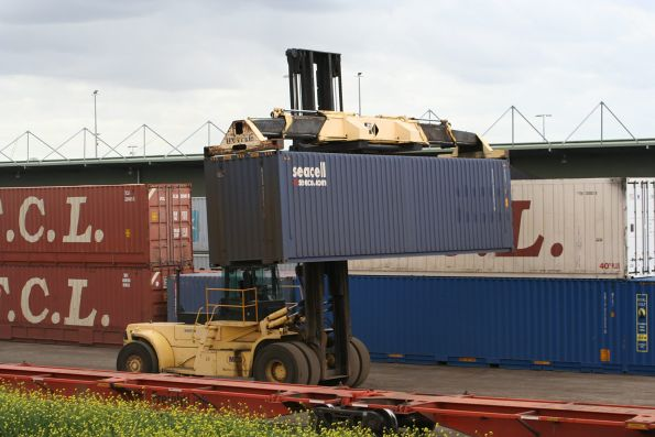 Container forklift moving a 40 foot container at North Dynon