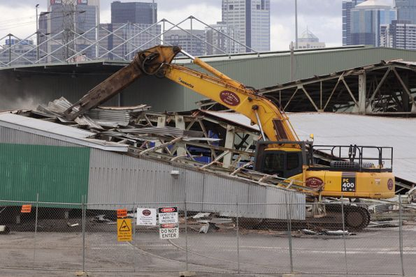 The giant claw easily tearing off the corrugated iron roofing
