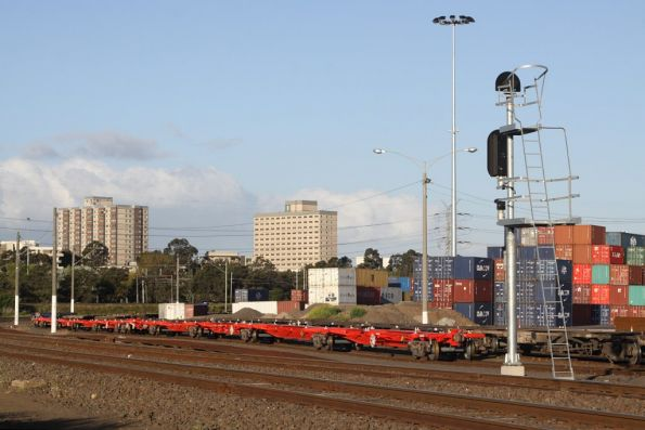 Rake of new QRN container flats stabled at North Dynon, the new container park in the background