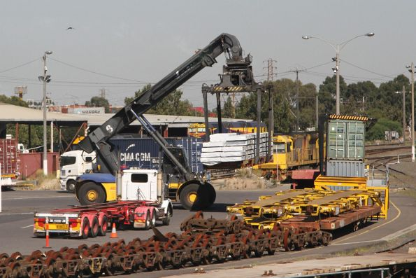 Reach stacker moving a flatrack container at North Dynon
