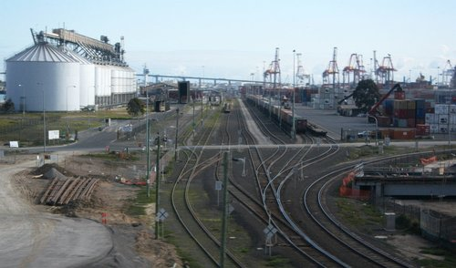 Appleton Dock sidings from CityLink, the Enterprize Road level crossing cutting across them all