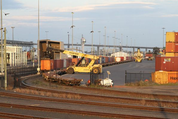 Reach stacker loading container wagons at Appleton Dock