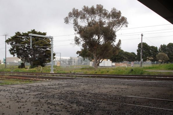 Former Somerton Road level crossing, in the shadows of the replacement road overbridge