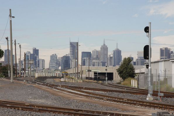 Looking east from Dock Link Road, Melbourne Operations Terminal atop the hill, line towards the docks to the right