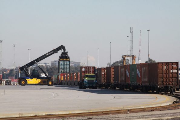 Reach stacker loading containers onto a Pacific National train at the Melbourne Freight Terminal