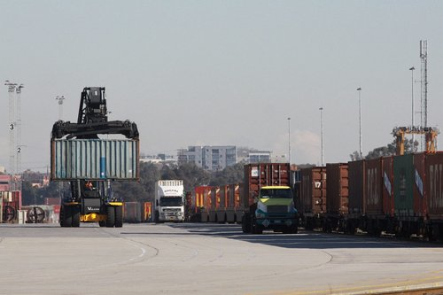 Reach stacker moving a 20 foot container around the Melbourne Freight Terminal