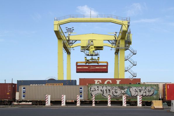 Rail mounted gantry crane lifting a 40 foot tautliner container at the Melbourne Freight Terminal