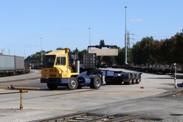 Terminal tractor moving an empty container 'skel' trailer around the terminal