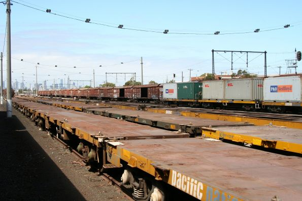 Stored flat and louvred wagons, along with loaded container for somewhere