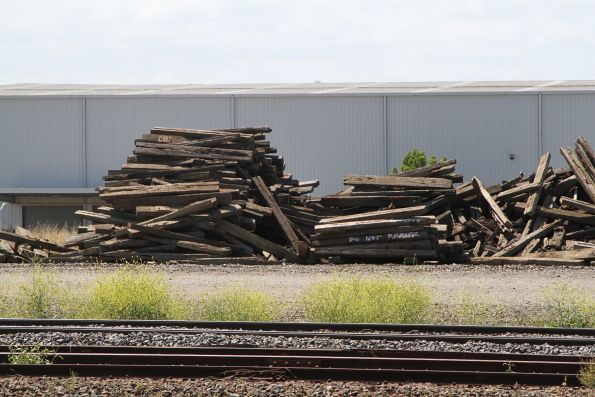 Stockpile of removed timber sleepers beside the SG main line