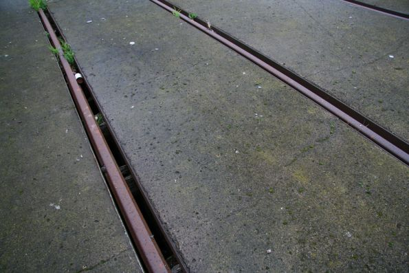 Concrete goes up to the rails, with a gap to the water below on either side