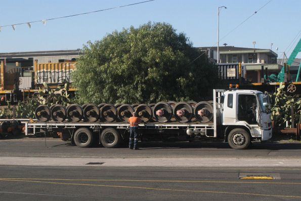 Tying down a truck load of freight wagon wheelsets