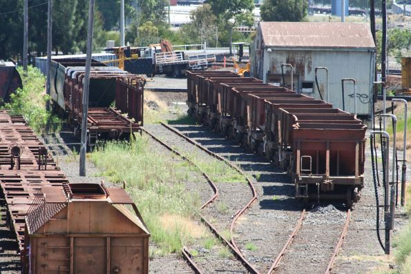 Elderly stock at the Wagon Storage Yard: a GH hopper and container wagons, VHEF hoppers and sleeper discharge wagons, then VZMA ballast hoppers