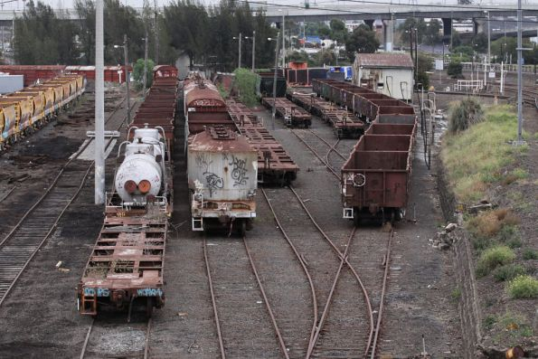 Reorganised Wagon Storage Yard - from L to R: NN ballast hoppers and misc way and works, flour wagons and old V/Line junk, three rakes of junky container flats, then VOFX open wagons formerly used on spoil trains