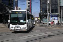 Driver Bus Lines 6109AO on a route 12 and 96 tram replacement service passes Port Junction