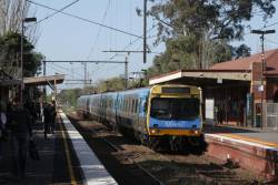 Flemington Racecourse train passes through Newmarket station on the down