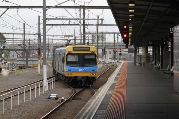 Comeng train departs Southern Cross platform 8 with a service to Flemington Racecourse