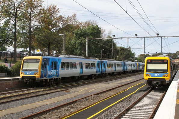 X'Trapolis train departs Flemington Racecourse for the city, with X'Trapolis 232M waiting in platform 2