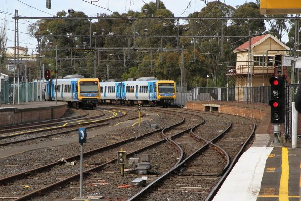 Up and down trains pass at Flemington Racecourse
