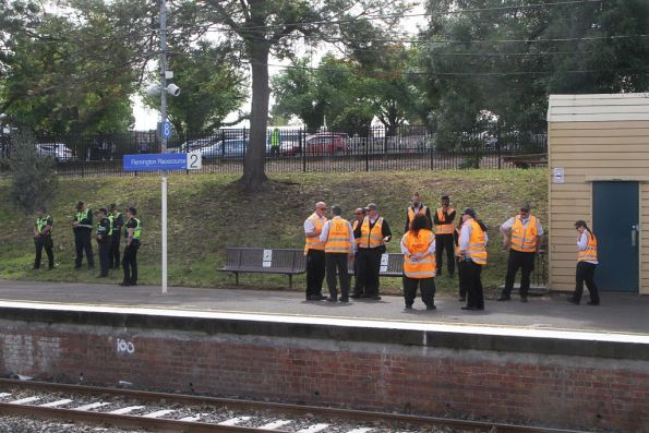 Victoria Police and Authorised Officers waiting at Flemington Racecourse platform 2