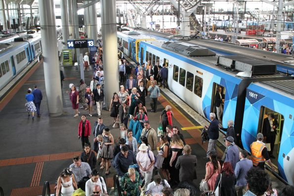 Melbourne Cup crowd exits the train at Southern Cross