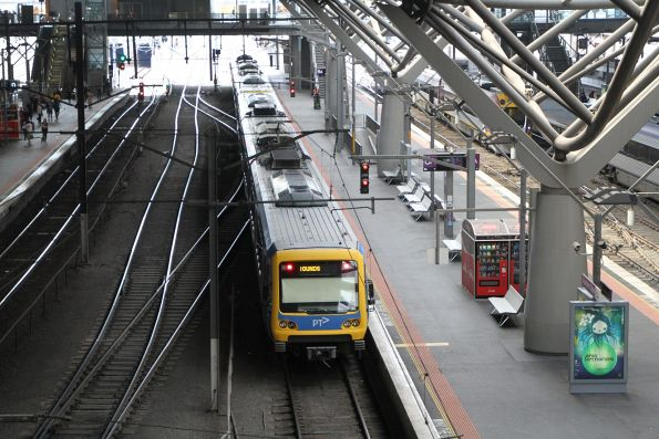 X'Trapolis train waiting at Southern Cross platform 8 with a 'Showgrounds' service