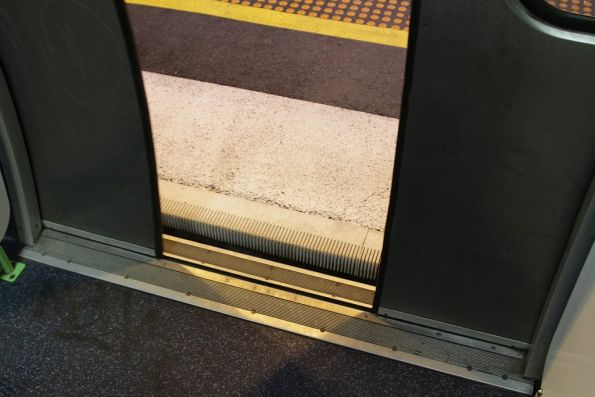 Almost level entry to the first carriage of a Comeng train thanks to raised platform extensions