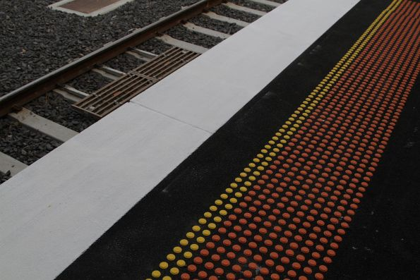 'Regional' standard tactile markings on a platform - 2x yellow and 10x orange