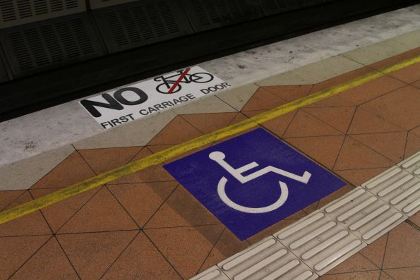Wheelchair passengers signage at the first carriage mark of the platform at Flagstaff station