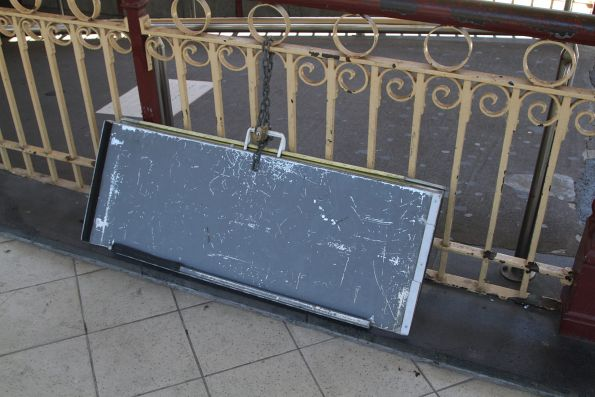 Wheelchair ramp chained to the platform fence at Flinders Street Station