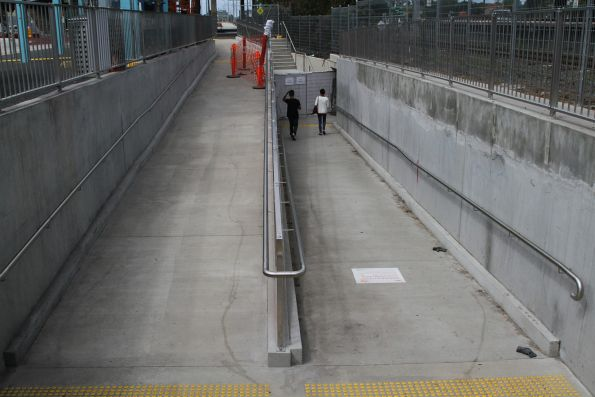 DDA compliant ramp links the existing pedestrian subway to the new bus interchange at Huntingdale station