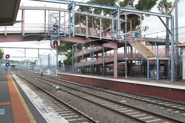 Long DDA compliant ramp up to the footbridge at Sunbury station