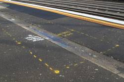 'DDA shelter' marked on the platform at the up end of Tottenham station