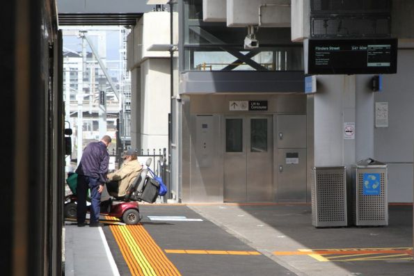 Portable ramp still needs to be deployed for a wheelchair user at Footscray station, despite the raised section of platform