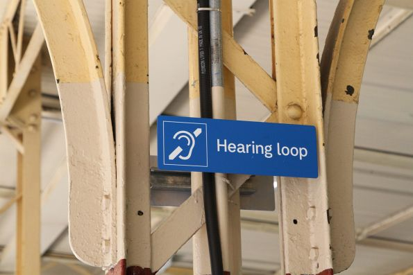 Hearing loop signage on the platforms at Flinders Street Station