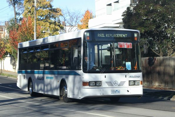 Nuline Charter bus #79 1116AO heads west on Toorak Road on a Glen Waverley rail replacement service
