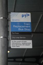 Train replacement bus stop sign outside Flinders Street Station