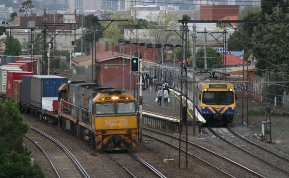 NR73 and NR98 overtake a Comeng suburban at Middle Footscray