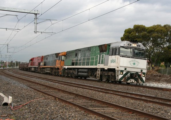 Southern Spirit liveried NR84 leads a vanilla NR and Ghan liveried NR75 at Coolaroo