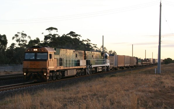 New and old green liveries- Trailerail NR55 and Southern Spirit NR85 Melbourne bound at Werribee