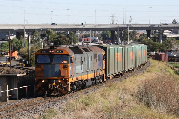 NR liveried 8114 shunts loading out of the east end of South Dynon towards the North Melbourne Flyover
