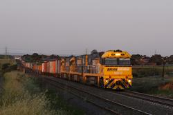 NR17, NR32 and NR119 lead a Melbourne bound freight over the Maribyrnong at McIntyre Loop